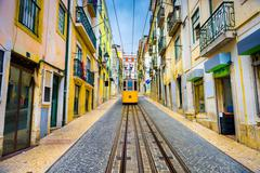 Lisbon, Portugal old town streets and street car. - stock photo