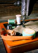 The sewing machine and tools. - stock photo