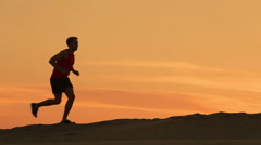 Running runner man jogging at sunset silhouette Stock Footage