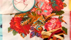 Bright embroidery with flowers, flosses thread and hoop Stock Footage