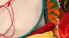 Hoop with thread and bright embroidery, flosses, close up Stock Footage