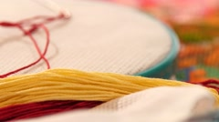 Hoop with embroidery, confidant, threads and floss, close up Stock Footage