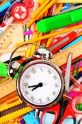 Stationery and alarm clock. - stock photo