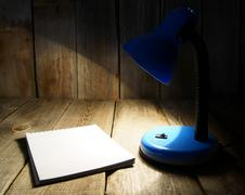 Notebook and the fixture. On wooden background. - stock photo