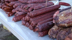 Different types of dry sausages on stand Stock Footage