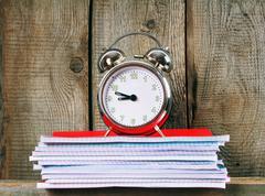 Writing-books and an alarm clock . Kuvituskuvat