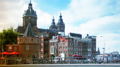 Rush hour in Amsterdam with Church of St Nicholas in background.time lapse,4k, Stock Footage