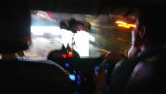 BANGKOK - CIRCA 2015: Driver is driving a taxi in the night city. Motion blur - stock footage