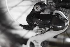Gearshift of the mountain bicycle with a chain,  Selective focus - stock photo