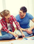 Smiling couple looking at color samples at home Stock Photos
