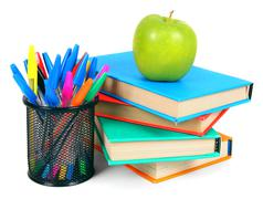 Books, an apple and pencils. On white background. Stock Photos