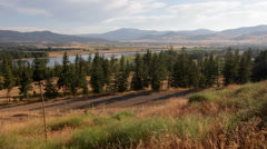 Road on hill forest valley pan Stock Footage