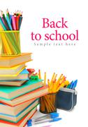 Back to school. Books and school accessories. On a white background. Stock Photos