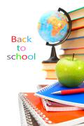 Ack to school. The globe, an apple and books on a white background. Stock Photos