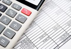 The calculator on documents. Accounts department - stock photo