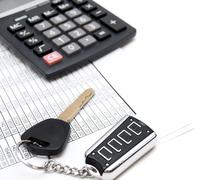 Calculator, keys from the car and documents Stock Photos
