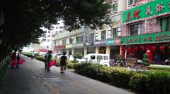 Female attendant hotel training dance on the sidewalk - stock footage