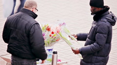 Black Man Buys Flowers From Street Vendor Stock Footage