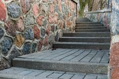 tortuous ascent of the stone steps - stock photo