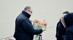 Two Women Buy Flowers From Street Vendor Stock Footage