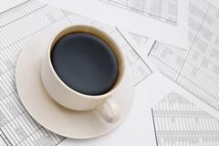 Coffee on documents. Stock Photos