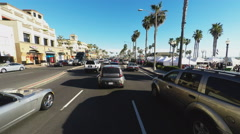 POV Of Driver On Pacific Coast Highway Past Huntington Beach Shops - stock footage