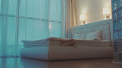 DOLLY MOTION: Double bed in the hotel room Stock Footage