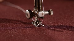 Old sewing machine on vinous cloth, close up, slow motion Stock Footage