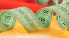 Measuring tape isolated on yellow cloth, close up Stock Footage