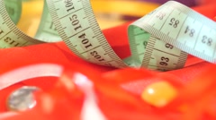 Measuring tape isolated on yellow and red clothes, close up Stock Footage