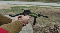 Firing pistol crossbow 3 Stock Footage
