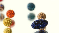 Varicolored, shiny beads on white background, cam moves to the left, rotation Stock Footage
