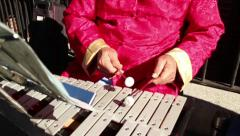 60 fps slow motion reverse: Chinese Xylophone Player Stock Footage