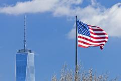 New York, USA-Freedom Tower in Lower Manhattan and US Flag - stock photo