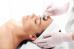 Rejuvenation, beautification, the woman at the beautician, Mesotherapy microneed - stock photo