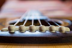 Acoustic Guitar Strings and Bridge Stock Photos