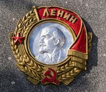 Soviet Lenin Emblem on Stone - stock photo