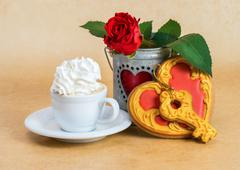Cup of coffee with cream and Valentine's Day heart shaped cookies - stock photo