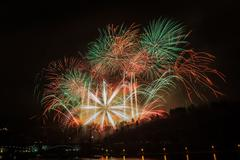 Great fireworks celebration of new year on dark night sky in Prague. Full of col - stock photo