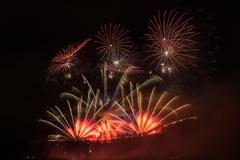 Stock Photo of Great fireworks celebration of new year on dark night sky. Full of colors and sp