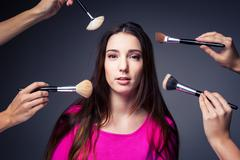 Pretty, young woman in the able care of professional make-up art - stock photo