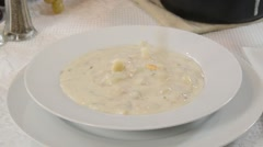 Clam chowder and crackers - stock footage