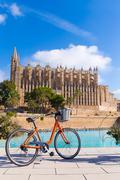 Majorca Palma Cathedral Seu and bicycle Mallorca - stock photo