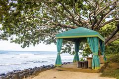 Cabana on sandy beach overlooking ocean Stock Photos
