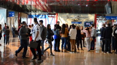 People in the reception of trade fair Stock Footage