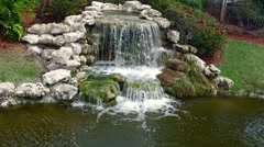 Aerial of waterfall to Country Club - stock footage