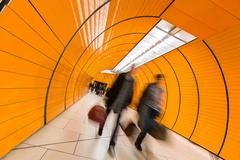 People rushing through a subway corridor (motion blur technique - stock photo