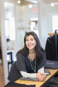 Hispanic small business owner smiling in store Kuvituskuvat