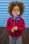 Pacific Islander boy blowing patriotic pinwheel Stock Photos