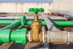 Valve mounted on rooftop industry building Stock Photos